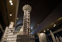 The Hyatt Regency Dallas and Reunion Tower were some of the notable Dallas landmarks constructed out of playing cards by professional cardstacker Bryan Berg during the State Fair of Texas in October, 2006. (Tom Fox/Staff photographer)