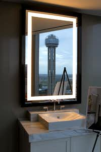 Reunion Tower is reflected in the bathroom mirror in the Presidential Suite at the Omni Dallas Hotel at the time of its opening in November, 2011. (Lara Solt/The Dallas Morning News)