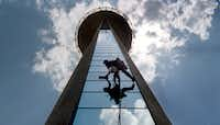 Blake Taylor of Eagle Highrise Inc.  cleans the windows on Reunion Tower's elevator shafts. The windows on the tower get cleaned three times a year on days with  very little wind. (The Dallas Morning News/Karen Stallwood)