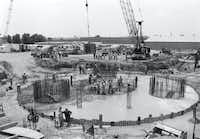 "The ""Table"" base of Reunion Tower being built in 1976. (Woodbine Development)"