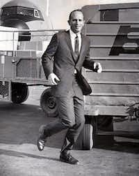 Dr. Kenneth Cooper demonstrates jogging while dressed in a suit during a shoot with legendary DMN photographer Jack Beers.(1968 File Photo)