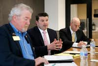"Dallas attorney J.J. Koch (center) answered questions in an editorial board meeting as former Garland City Council member Stephen Stanley (left) listened and former state District Judge Vickers ""Vic"" Cunningham took notes in February at <i>The Dallas Morning News.</i>(Vernon Bryant/Staff Photographer)"