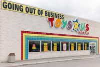 "A ""Going Out Of Business"" sign hangs over the Toys R Us store logo in Omaha, Neb.(Nati Harnik/The Associated Press)"