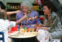 First lady Barbara Bush and Russian first lady Naina Yeltsin played with children during a visit to the children's program at Martha's Table in June 1992. Martha's Table is a non-profit organization that serves homeless and hungry people in Washington,D.C.(The Associated Press/1992 FIle Photo<div><br></div><div><br></div><div><br></div>)