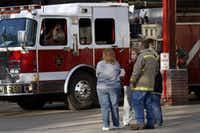 Residents and firefighters console each other outside the West Volunteer Fire Department in West, Texas, where a fertilizer plant exploded April 17,<div>&nbsp;2013.&nbsp;</div>(File photo/The Dallas Morning News)