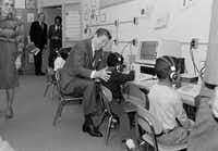 """President Ronald Reagan gets some instructions on computer operations while visiting the Congress Heights Elementary School in Washington in 1984. """"A Nation at Risk,"""" the report issued by Reagan's Education Department, was meant as a wake-up call for the country. It spelled out where the United States was coming up short in education and what steps could be taken to avert a crisis.(File Photo/The Associated Press)"""