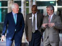 In this 2017 file photo, U.S. Sen. John Cornyn (left) toured The Bridge Homeless Recovery Center with Interim President and CEO of David Woody (center) and COO Sam Merten before handing out socks, sweatshirts and other clothing.(Ashley Landis/Staff Photographer)