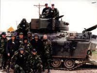 "<p><span style=""font-size: 1em; background-color: transparent;"">FBI tactical agents pose with one of the tanks used in the Branch Davidian siege near Waco.</span><br></p><p></p>(Courtesy Photo/Digital File)"