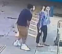 A still photo shows grainy images of two people suspected in an attack at a Fort Worth convenience store.(Fort Worth Police Department)