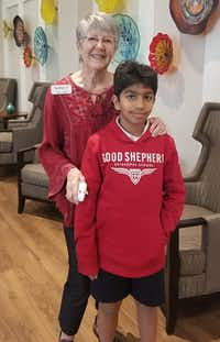 Nancy Miller and Ahan Jain pose for a picture after a pizza party at Presbyterian Village North. The two have been pen pals for months and finally met face-to-face.(Tommy Noel/Staff)