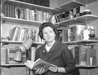 Rachel Carson  holds her book <i>Silent Spring</i> in the library of her Silver  Spring, Md., home in March 1993. ((DMN file) /AP)