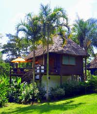 Cayo District activities lure families from cozy thatched-roof eco-cottages at the Lodge at Chaa Creek in Belize.(Picasa)