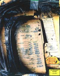 A government evidence photo of a charred receipt for over $13,000 in goods purchased from a gun shop on Northwest Highway in Dallas was found at the compound after the standoff ended with fire.(FBI)