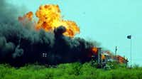 The Branch Davidian compound was rocked by an explosion after the Davidians set fire to it in response to being gassed by federal authorities on 51st and final day of the standoff.(Irwin Thompson/Staff Photographer)