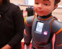 Milo the interactive robot helps explain facial expressions and social interaction to children during a class at Tom C. Gooch Elementary School in Dallas.  (Jason Janik/Special Contributor)
