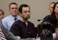 Larry Nassar sits during his sentencing hearing Jan. 24 in Lansing, Mich.  The former sports doctor who admitted molesting some of the nation's top gymnasts for years was sentenced Wednesday to 40 to 175 years in prison.(Carlos Osorio/AP)