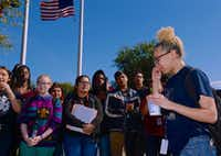 Junior Kealie Jordan (right) led her classmates in a sometimes emotional walkout at MacArthur High School in Irving.(Brandon Wade/Special Contributor)