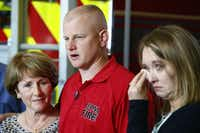Julie Needum mother, (from left) Andrew Needum and his wife Stephanie Needum talk about their experience on Southwest Airlines flight 1380 to the media at Celina City Fire Department.(Nathan Hunsinger/Staff Photographer)