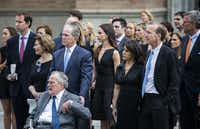 "<p><span style=""font-size: 1em; background-color: transparent;"">Former President George W. Bush escorts his father, former President George H.W. Bush, out of St. Martin's Episcopal Church in Houston. They had attended the funeral for former first lady Barbara Bush with family members including former first lady Laura Bush.</span></p>(Ashley Landis/Staff Photographer)"
