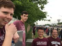 From left: Ryan Clark, Nathaniel Fasolino, Trent Jolie and Bruce Clark posed moments before former first lady Barbara Bush's casket traveled past a busy intersection on Saturday in College Station.(Robert T. Garrett/Staff)