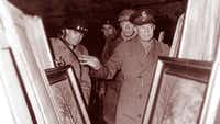 Allied soldiers, led by Gen. Dwight D. Eisenhower, who was later elected president in 1952, discover looted Nazi paintings during the war.(American Heroes Channel)