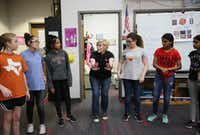Choir teacher Allison Hartzell teaches the dance steps to a song during a class at Coppell Middle School West. (Andy Jacobsohn/Staff Photographer)