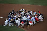 Members of the Republican and Democratic congressional baseball teams gather for a bipartisan prayer before the start of the Congressional Baseball Game at Nationals Park on June 15, 2017, in Washington, DC.  (Win McNamee/Getty Images)