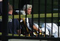 U.S. Rep. Roger Williams (R-TX) is wheeled away by emergency medical service personnel from the Eugene Simpson Stadium Park on June 14, 2017 in Alexandria, Va.(Alex Wong/Getty Images)