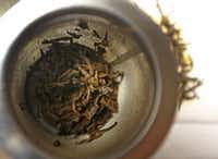 Himalayan Golden Tips tea leaves from Nepal, pictured after steeping at the Rakkasan Tea Company in Dallas.(Louis DeLuca/Staff Photographer)