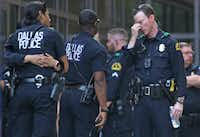 Dallas officers wait outside the emergency room entrance at Texas Health Presbyterian Dallas the day of the shootings.(Louis DeLuca/Staff Photographer)
