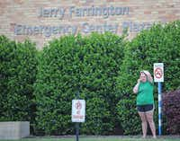 A person who knows the injured Home Depot loss prevention officer stands near the entrance to the emergency room at Texas Health Presbyterian Dallas, where the injured officers and civilian were taken.(Louis DeLuca/Staff Photographer)