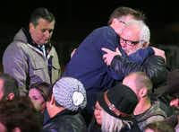 Texas Lt. Gov. Dan Patrick embraces hero Stephen Willeford, who shot and chased the gunman who attacked First Baptist Church of  Sutherland Springs. Senator Ted Cruz stands by at a memorial service at the Floresville High School football stadium in Floresville, Texas. Photographed on Wednesday, November 8, 2017.(Louis DeLuca/Staff Photographer)