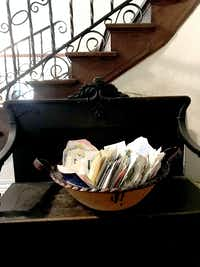 "<span style=""font-weight: normal;"">In the front hall of the McSwanes' home, they keep a bowl full of letters they received after the suicide of their son Patrick, who battled schizophrenia.</span>(KHN/Charlotte Huff)"