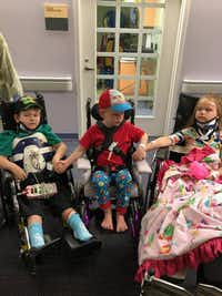 Zachary, 5, Wyatt, 4, and Angela, 8, were reunited at a Fort Worth hospital after surviving a fatal crash that claimed the lives of their parents and youngest sibling. (Facebook)
