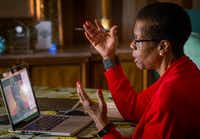 Beverley Wright works from home with a client in Atlanta via a conference app.(Robert W. Hart/Special Contributor)