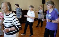 Louise Pierson (center) dances with her group during a line dancing class for seniors at Atria Canyon Creek in Plano.(Nathan Hunsinger/Staff Photographer)
