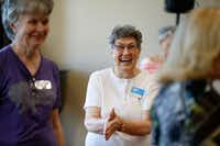 Louise Pierson claps during a line dancing class for seniors at Atria Canyon Creek in Plano.(Nathan Hunsinger/Staff Photographer)