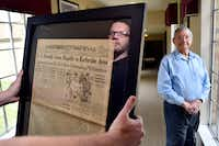 "<p><span style=""font-size: 1em; background-color: transparent;"">Will Williford, director of sales and marketing, left, is seen in the reflection of a glass frame, and Air Force veteran Jorge Masek, 87, at the Treemont Retirement Community in North Dallas. The newspaper clipping Williford is holding is one of four clippings that is framed and on display at the center honoring the veteran residents.</span></p>(Ben Torres/Special Contributor)"