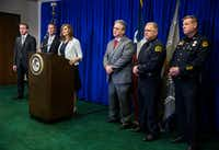 U.S. Attorney Erin Cox announces the Dallas arrest of several members of the Aryan Brotherhood on April 30, 2018, at the Earle Cabell Federal Building in downtown Dallas. Captain Phillip Fuller of the Texas Department of Public Safety is second from left, and Texas Anti-Gang Center Administrator Todd Reichert is third from right. (Ashley Landis/Staff Photographer)