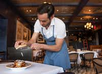Julian Barsotti adds cheese to his Sunday gravy.(Rex C Curry/Special Contributor)