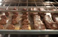 Meatballs and ribs cook in the oven for Julian Barsotti's Sunday gravy.(Rex C Curry/Special Contributor)