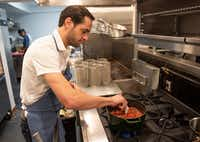 Julian Barsotti stirs his Sunday gravy in the kitchen at Fachini in Dallas.(Rex C Curry/Special Contributor)