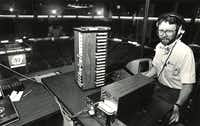 "<p>Mike Garner sits in the booth from which he controls the Reunion Arena PA system and scoreboard in <span style=""font-size: 1em; background-color: transparent;"">May 1984, shortly before Game 3 of the Mavericks Western Conference semifinal series against the Los Angeles Lakers, which the Mavericks would lose in five games. The 1983-84 season marked the franchise's first playoff berth.</span></p>(1984 File Photo/Staff)"