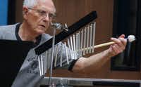 "<p><span style=""font-size: 1em; background-color: transparent;"">James Meine, 83, strikes a set of chimes at the Denton New Horizons Band rehearsal at the Denton Senior Center.He has been a percussionist since the 7th grade.</span></p>(Ron Baselice/Staff Photographer)"