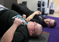 Josh Walters, 28, (left) and Daniel Stein with Special Strong exercise at Anytime Fitness in McKinney.(Jason Janik/Special Contributor)