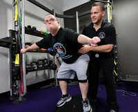Josh Walters, who is 28 and has Down syndrome, has regained interest in life after working with Special Strong, the fitness company for special needs started by Daniel Stein (right). (Jason Janik/Special Contributor)