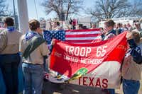 Boy Scouts color guard members in Denton present the U.S. flag and the Troop 65 flag to raise it on the flag pole. (Jake King/Denton Record-Chronicle)