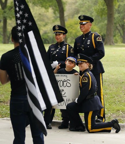 Dallas hero officer's relatives take comfort in the embrace