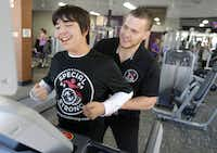 "<span style=""font-weight: normal;"">Alfredo Benitez (left) works out with Daniel Stein at Anytime Fitness in McKinney. Stein is owner of Special Strong, which helps special needs individuals find strength and purpose through exercise. </span>(Jason Janik/Special Contributor)"