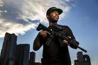 Collins Idehen, an NRA TV host who goes by Colion Noir, shown with his Heckler & Koch MR 556 A1 rifle, carries a gun with him at all times.(Smiley N. Pool/Staff Photographer)